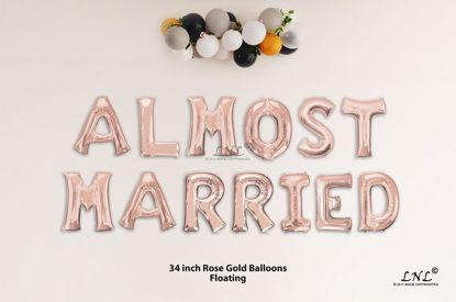 Picture of ALMOST MARRIED Rose Gold Letters 34 Inch Foil Balloons